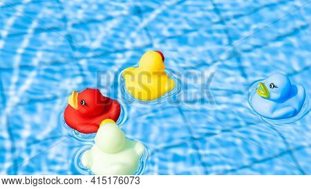 Yellow Rubber Duck. Funny Kids Inflatable Toy Float In Blue Water Of Summer Pool. Funny Bird Toy For