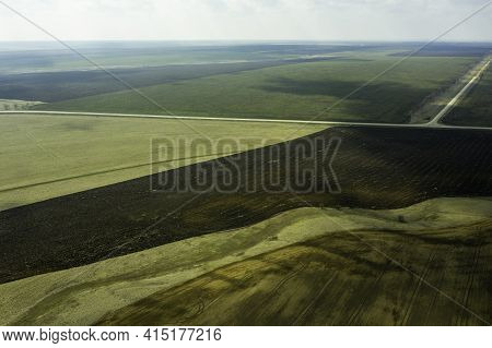 A Wedge Of Arable Land Among Fields Spring Landscape Shooting From A Drone