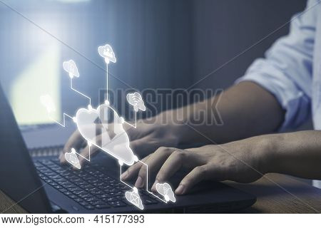 Businessman Using Laptop Computer With Virtual Cloud Technology With Icon . Cloud Technology Managem