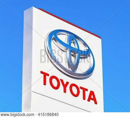 Moscow, Russia - June 13, 2016: Official Dealership Sign Of Toyota Against The Blue Sky Background.