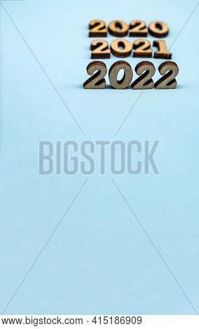 Banner 2022. Figures 2022 On Blue Background. Wooden Figures On Blue Background. New Year's Calendar