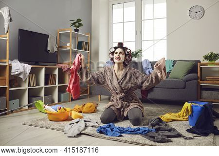 Tired Housewife Picking Up Clothes From Floor And Complaining About Constant Mess At Home