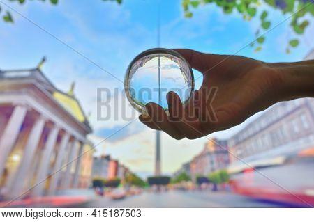 A Glass Lens Ball And Famous Landmark Spire In Dublin, Ireland