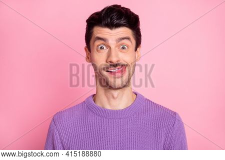 Portrait Of Attractive Cheerful Hilarious Guy Licking Lip Having Fun Isolated Over Pink Pastel Color