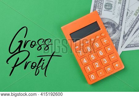 Top View Of Calculator And Money Banknotes With Text Gross Profit