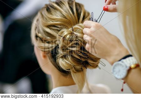 Professional Hairdresser With Red Manicure Doing Her Hair In The Women's Salon. Lots Of Hair Pins. S