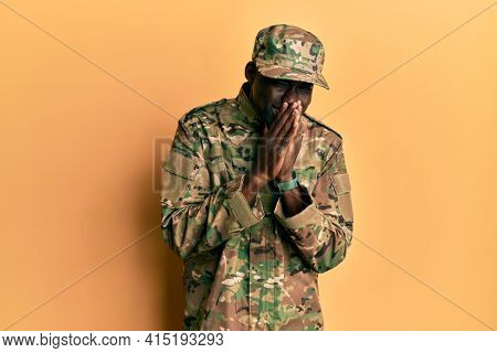 Young african american man wearing army uniform laughing and embarrassed giggle covering mouth with hands, gossip and scandal concept
