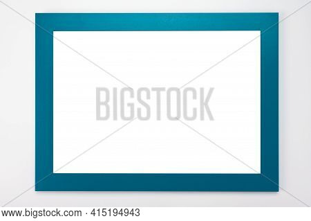 Horizontal Frame Mockup. Isolated On White Background. White Poster With Cyan Frame Mockup. Man Hand