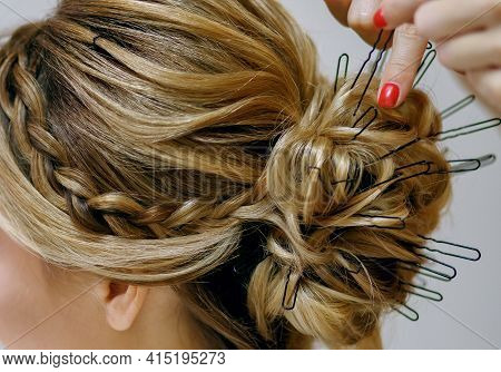 Professional Stylist With Red Manicure Doing Hairdo In The Women's Beauty Salon. Lots Of Hairpins In