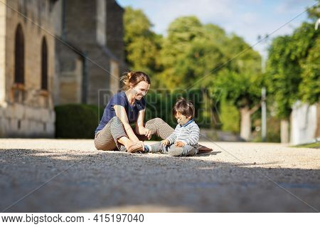 Mother And Little Eastern Handsome Baby Boy Playing Outdoor In The Park. Happy Mixed Race Family In