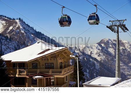 Cableway Cabin Above The Wooden Chalet In A Ski Resort