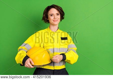 Photo Of Young Woman Firefighter Happy Positive Smile Hold Helmet Brave Safety Isolated Over Green C
