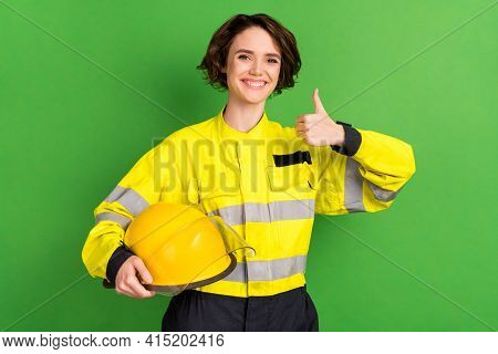 Photo Of Young Woman Firefighter Happy Positive Smile Hold Helmet Show Thumb-up Advert Advice Fine I