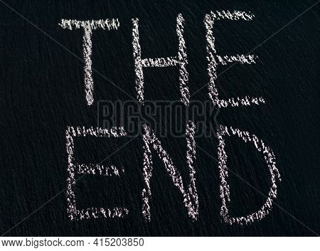 Writing The End In Chalk On A Rough Black Board To Indicate The End Of The Viewing Or Process. The C