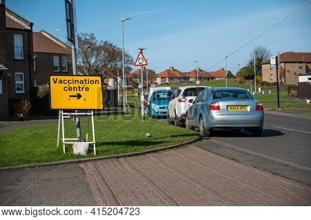 Amble, Northumberland, Uk - March 21, 2021: Vaccination Centre Temporary Road Sign On A Housing Esta