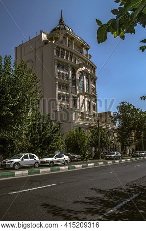 Tehran,iran,july 07,2020:tall Building With A Blue Dome, Spire, Gazebos, Columns And Oval Windows On