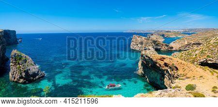 Stone cliffs on the blue lagoon of the island of Comino and Gozo Malta. Mediterranean Sea
