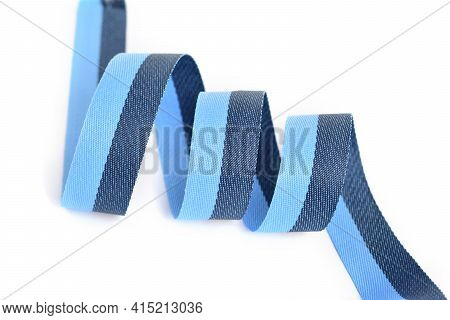 Blue Cotton Ribbon, Roll Textilies On Bobbin. Strapping Tape With Curl On White Backgroud.