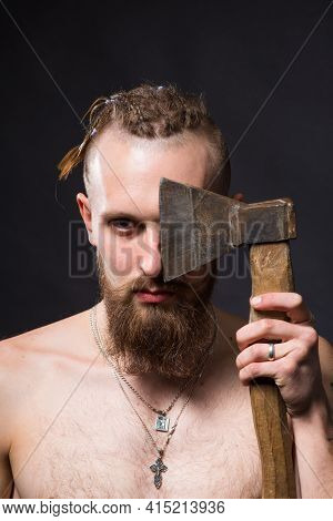 Young Handsome Man With Bushy Beard And Large Mustache Covered Half Of His Face With An Ax