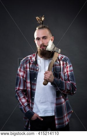Young Handsome Man With A Thick Beard And A Large Mustache In A Plaid Shirt Shaves His Beard With An