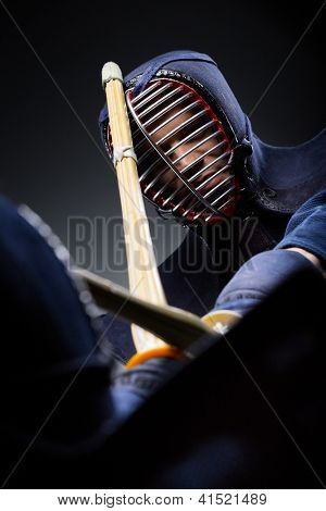 Close up shot of competition of two kendo fighters. Japanese martial art of sword fighting