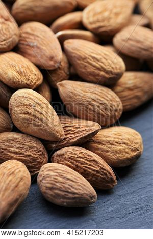 Almond Nut. Raw Almonds Nuts Heap On Slate Background.nuts And Seeds Closeup.tasty Snack. Healthy Fa