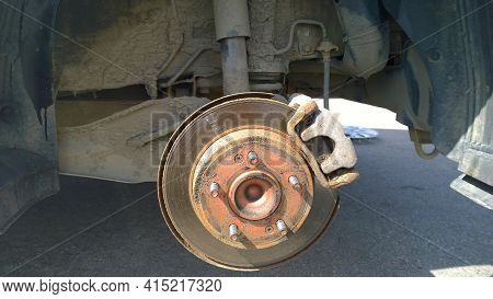 Replacing Brake Disc And Car Pad. Changing Flat Tire On Your Own. Caliper Wheel. Safety Driving. Tyr