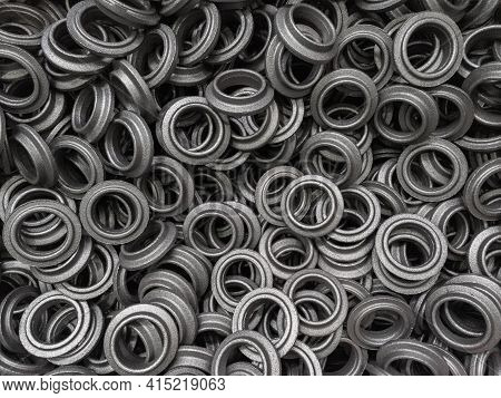 Heap Of Grey Steel Ring Forgings After Shot Blasting - Close-up Natural Heavy Industrial Pattern Wit
