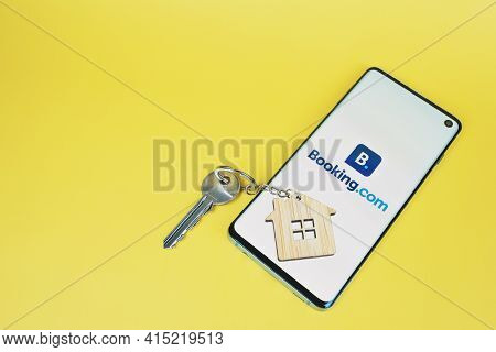 Phone With Booking Com Logo, Key With House Key Chain