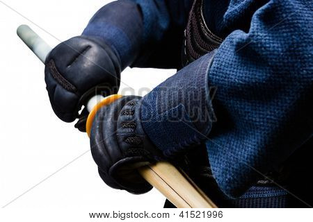 Close up of hands in kote with shinai, isolated on white. Japanese martial art of sword fighting