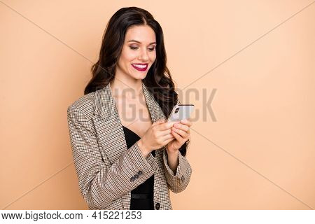 Photo Of Cute Shiny Young Lady Dressed Checkered Smiling Typing Modern Device Empty Space Isolated B
