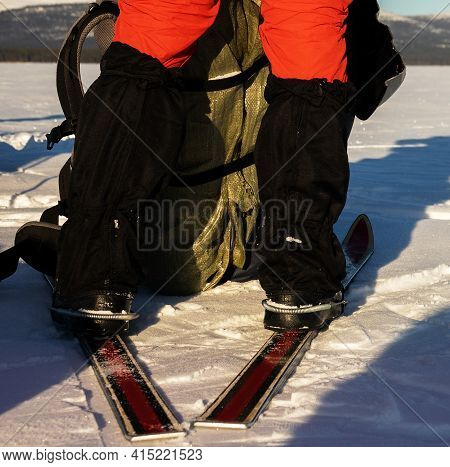 Skier's Legs And Skis (frontale Position). Tourist Skier On A Long Distance Route