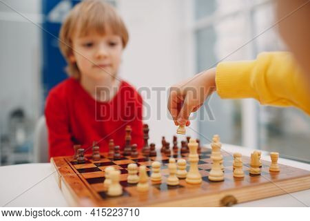 Little Kids Playing Chess At Kindergarten Or Elementary School. Childrens Chess Play.