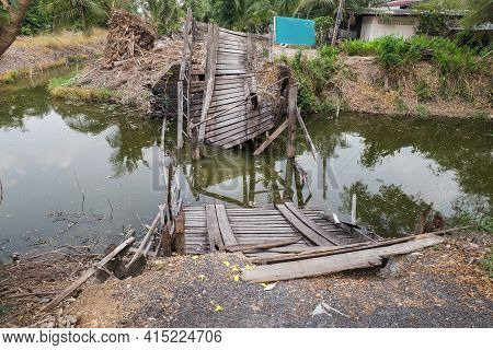 Old Collapsing Wooden Bridge Into The Canal In A Rural Village. No Focus, Specifically.