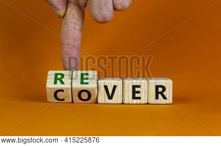 Recover Symbol. Concept Word 'recover' On Wooden Cubes On A Beautiful Orange Table. Businessman Hand