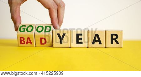 Bad Or Good Year Concept. Businessman Turns Cubes And Changes Words 'bad Year' To 'good Year'. Beaut
