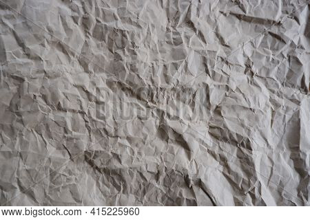 Top View Photo Of Crumpled Craft Paper. Paper Background With Copyspace. Vintage Paper Canvas Textur