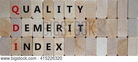 Qdi, Quality Demerit Index Symbol. Wooden Blocks With Words 'qdi, Quality Demerit Index'. Beautiful
