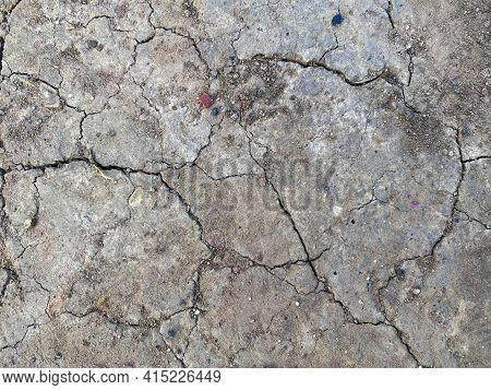 Drought Land With Dry And Cracked Ground. Waterless Surface, Dry Soil In Arid Areas. Global Warming