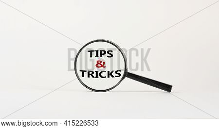 Tips And Tricks Symbol. Magnifying Glass With Words 'tips And Tricks'. Beautiful White Background. B
