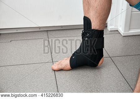 The Male Leg Is Fixed In A Medical Bandage. Ankle Fracture Or Sprain. Lacing And Tight Fit Of The Fo