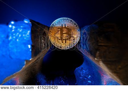 Bitcoin Mounted In A Steel Vise Isolated With Black Background. Keeping Bitcoin Safe In Crypto Walle
