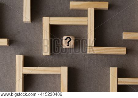 Maze Or Labyrinth Made With Wooden Blocks With A Wooden Cube With Question Mark In The Middle. Busin
