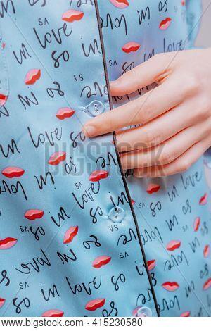 Beautiful Sexy Woman Wearing A Blue Pajama. Fashion Model On A Beige Background.