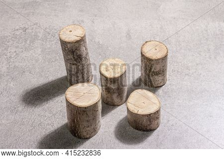 Modern Set Of Wooden Stand Podiums On Grey Stone Concrete Background