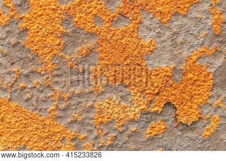 Orange Painted Peeling Stained Cement Wall Surface. Close-up. Abstract Backdrop