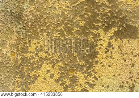Weathered Cement Painted Yellow Wall Texture. Abstract Background
