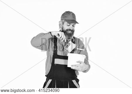 Talented Master. Painting Walls. Priming Entire Wall. Bearded Mature Man Painter. Wall Painter With