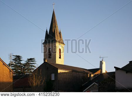Bell Tower Of The Church In The South Of France At Saint-pierre-de-trivisy During The Sunset