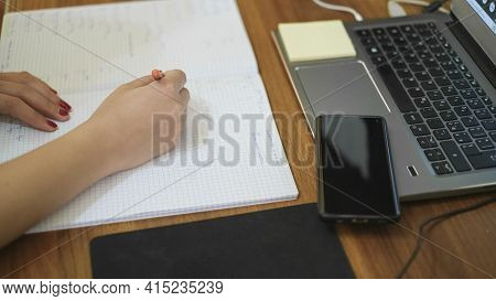 Woman Studying At Home While Use Notebook For Remote Schooling, Covid-19 Pandemic Social Distancing